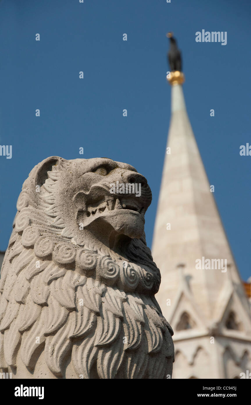 Hungary, capital city of Budapest. Buda, Castle Hill, lion statue in front of castle towers of the Fishermen's - Stock Image