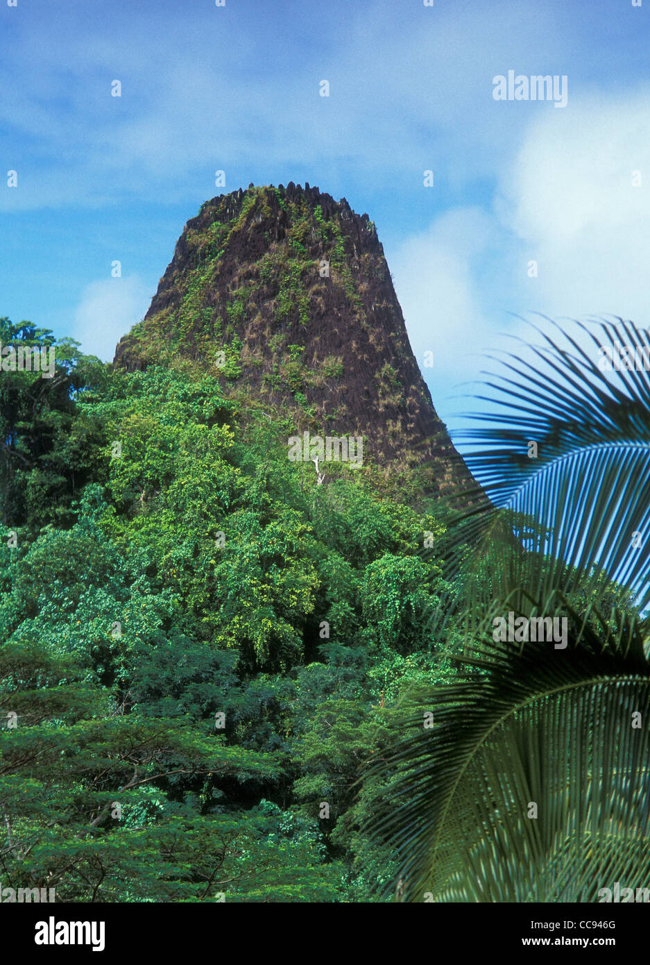 Pwusehn Malek (also known as Chickenshit Mountain), a volcanic plug; Pohnpei, Micronesia. - Stock Image