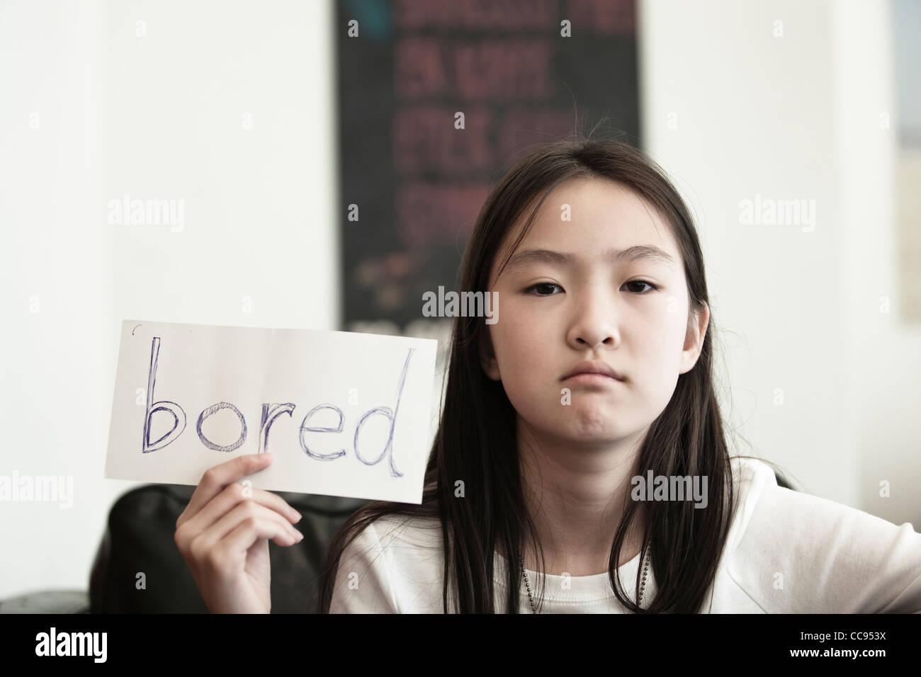 Asian girl holding sign