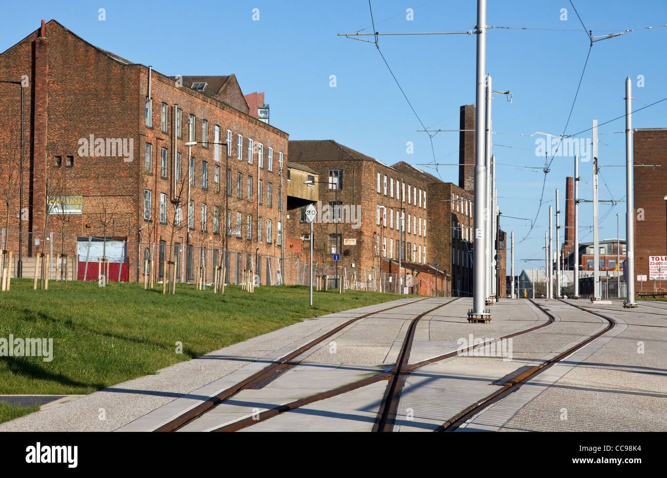 New Metrolink East Manchester Line line to Ashton passes old cotton mills (Chapeltown St ), Ancoats area , Manchester,UK - Stock Image