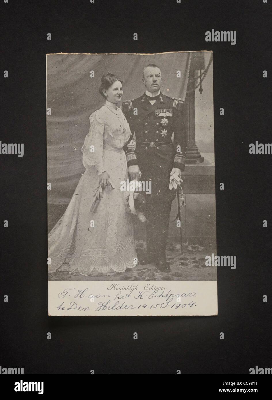 Dutch young queen Wilhelmina of Orangeantique and her German husband Hendrik von Meckelenburg in 1904 in a studio Stock Photo