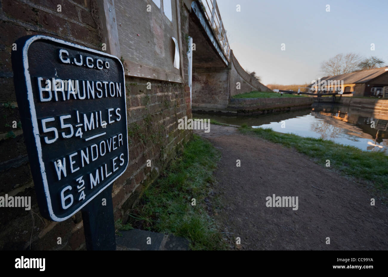 Mile marker showing distance to Braunston and Wendover at Bulbourne Junction on the Grand Union Canal, Herts UK - Stock Image