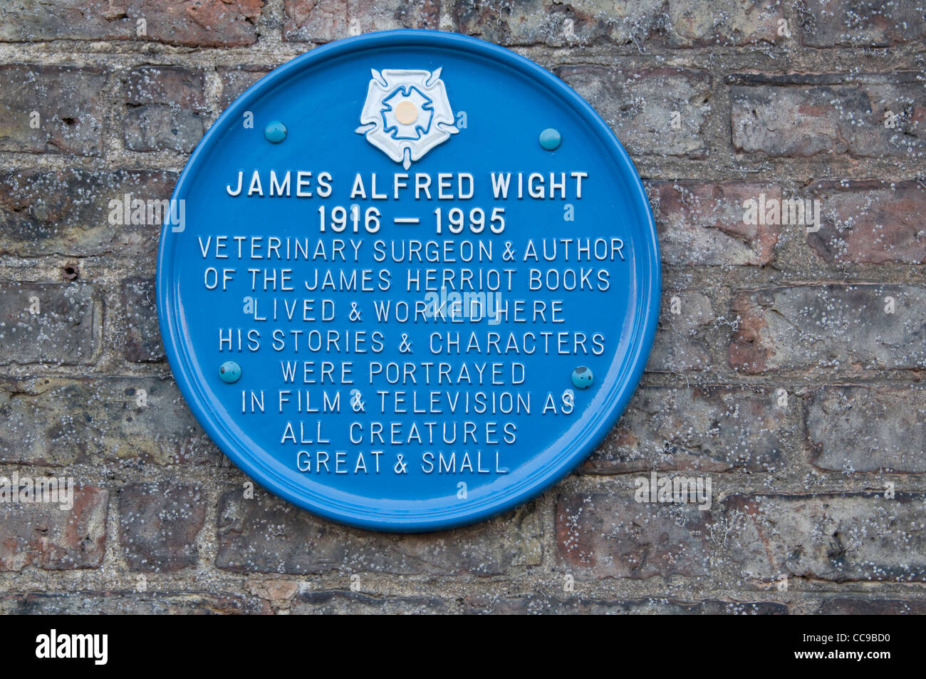 A plaque on the wall at the vet's practice of Alf Wight, a country vet known as James Herriot in the market - Stock Image