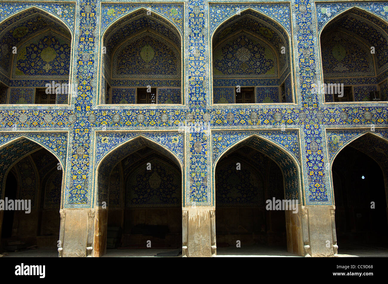 The main courtyard of the Imam Mosque in Isfahan, Iran, is surrounded by highly decorated two storey porches. - Stock Image