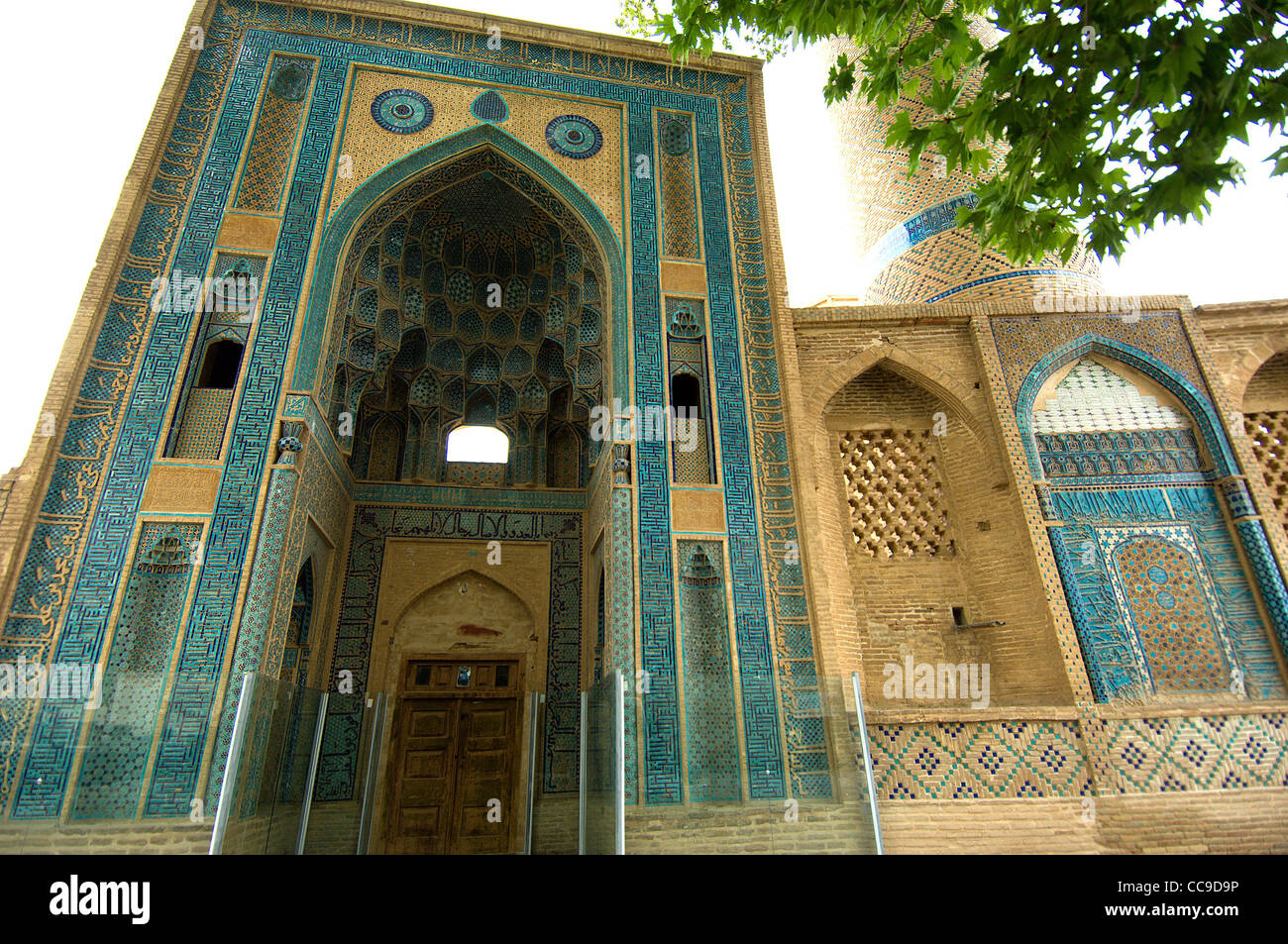 The Jameh (Friday) Mosque in Natanz, Iran is well-known for its unusually high entrance portal and its unusual calligraphy. - Stock Image