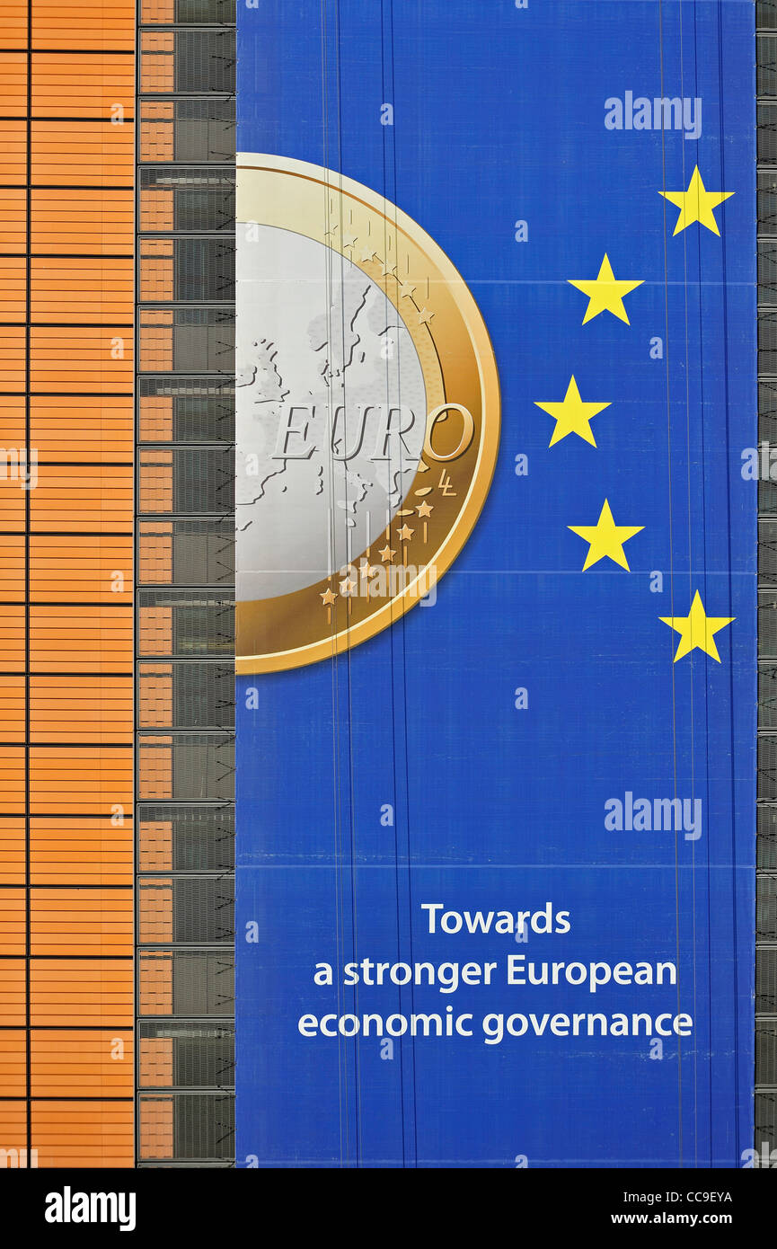 Banner about the euro hanging from building of the European Commission, executive body of European Union in Brussels, - Stock Image