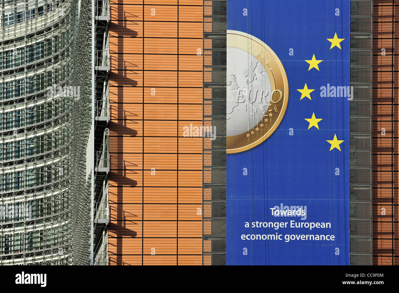 Banner about the euro hanging from building of the European Commission, executive body of European Union in Brussels, Stock Photo