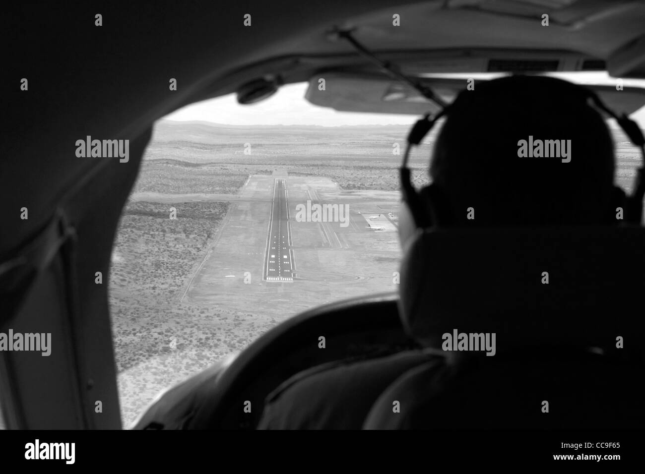 View over pilot's shoulder on approach at Windhoek Hosea Kutako International Airport - Namibia, Africa - Stock Image