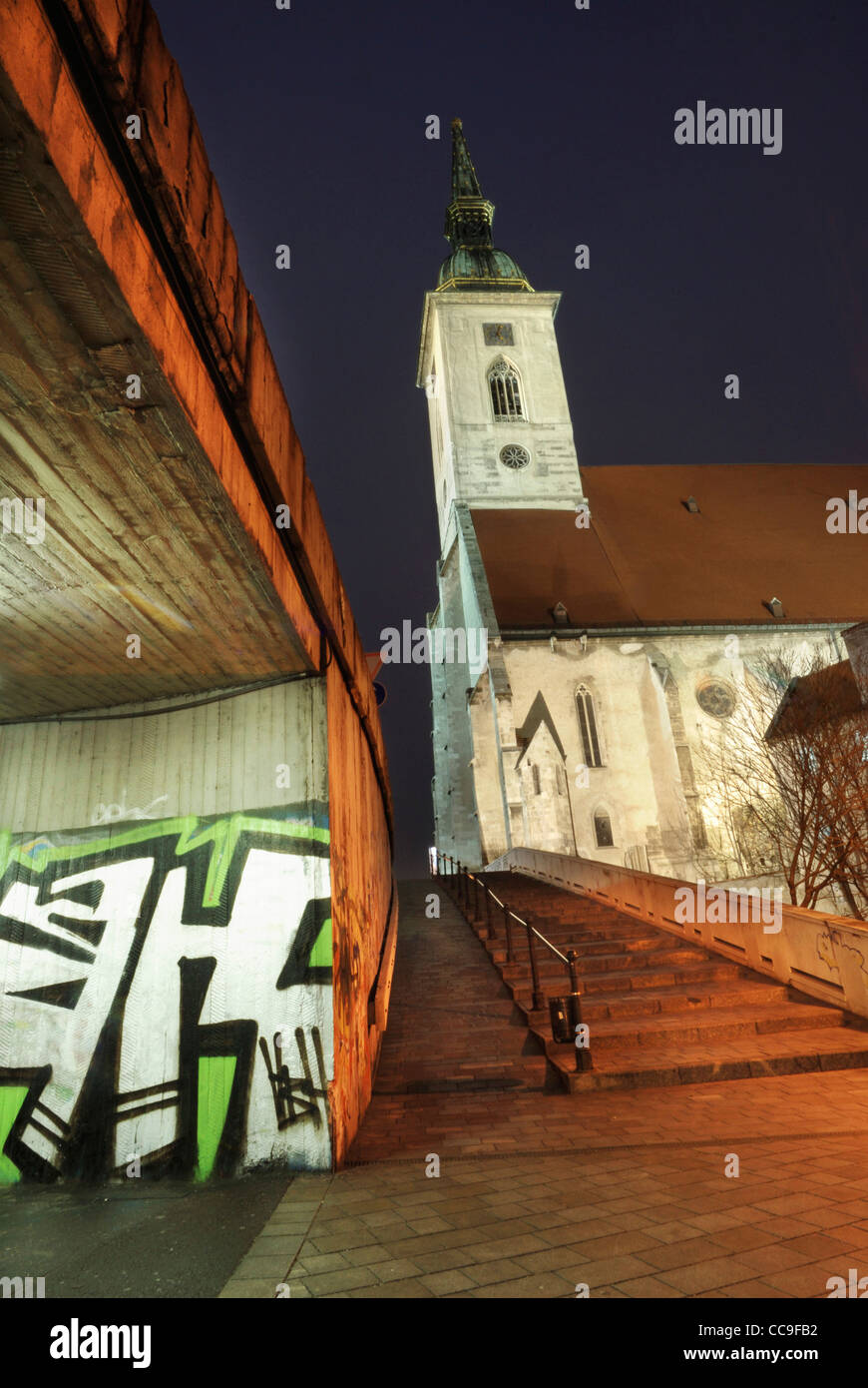 Graffitti in underpass looking up at st martins cathedral, Bratislava, Slovakia - Stock Image