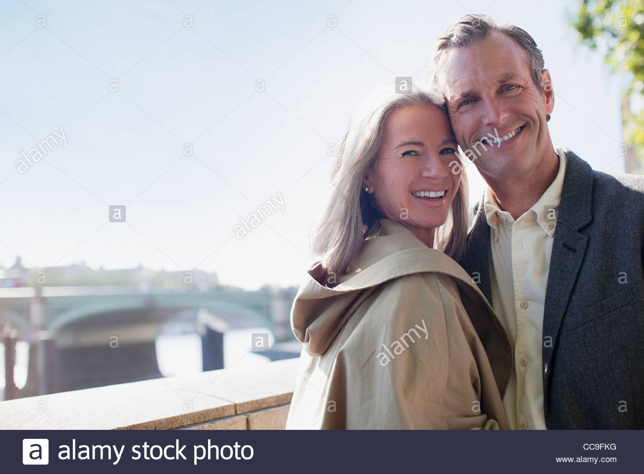 Portrait of smiling couple - Stock Image