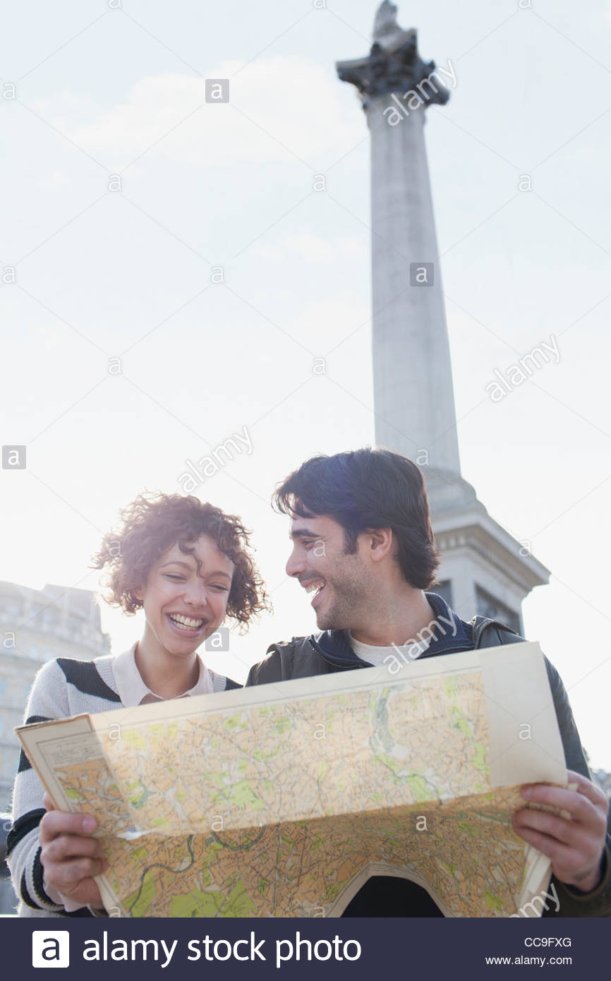Happy couple with map below Nelsons Column - Stock Image