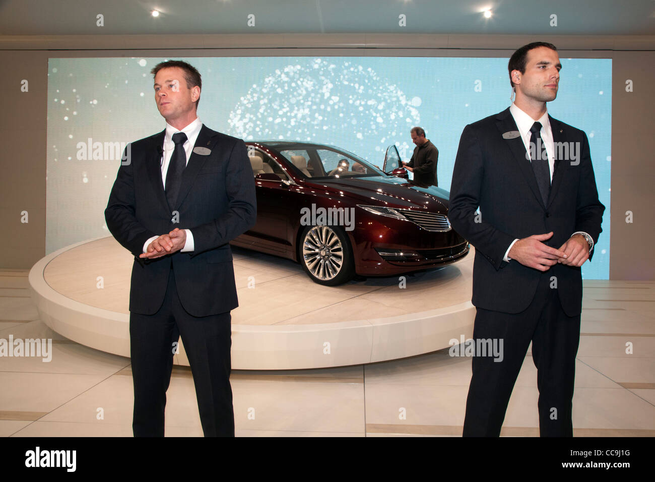 Models dressed as security agents protect the 2013 Lincoln MKZ at the Detroit Auto Show - Stock Image