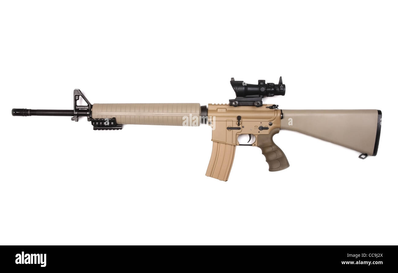 Sand-painted M16A4 assault rifle with ACOG riflescope. Isolated on a white background. Studio shot. - Stock Image