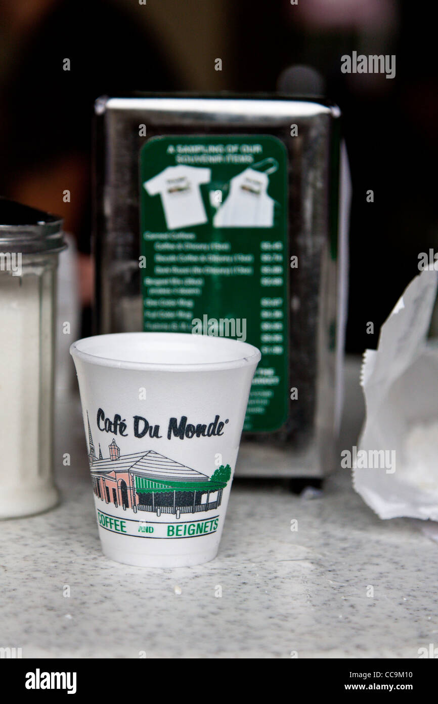 Foam coffee cup on table at Cafe Du Monde in the French Quarter of New Orleans, LA - Stock Image
