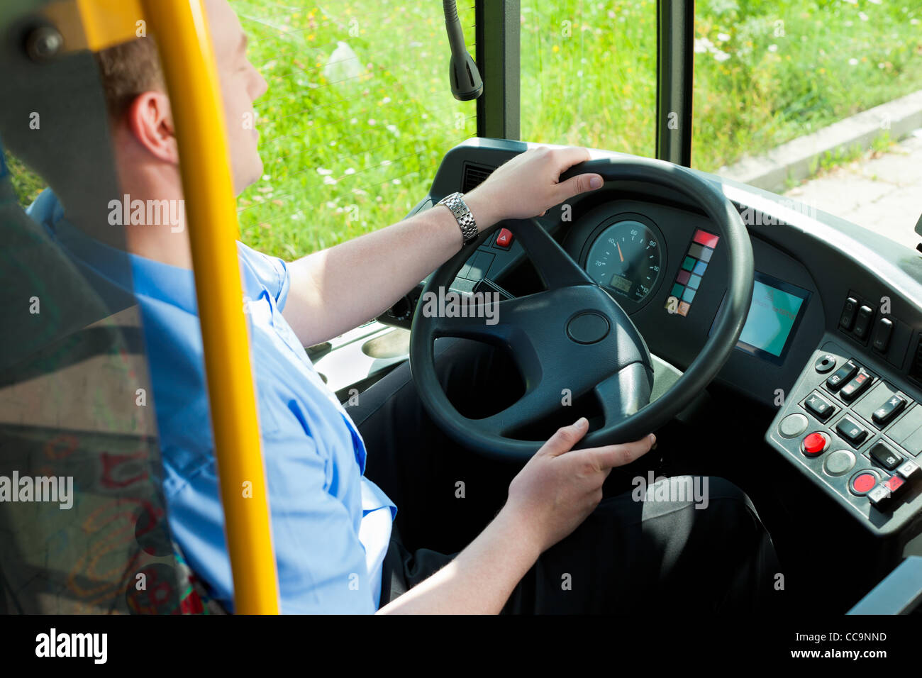 Bus driver sitting in his bus on tour - Stock Image