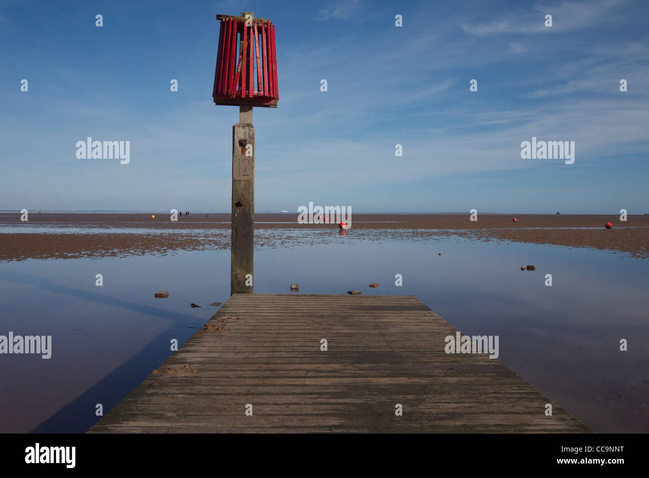 High tide marker & jetty at Cleethorpes beach - Stock Image