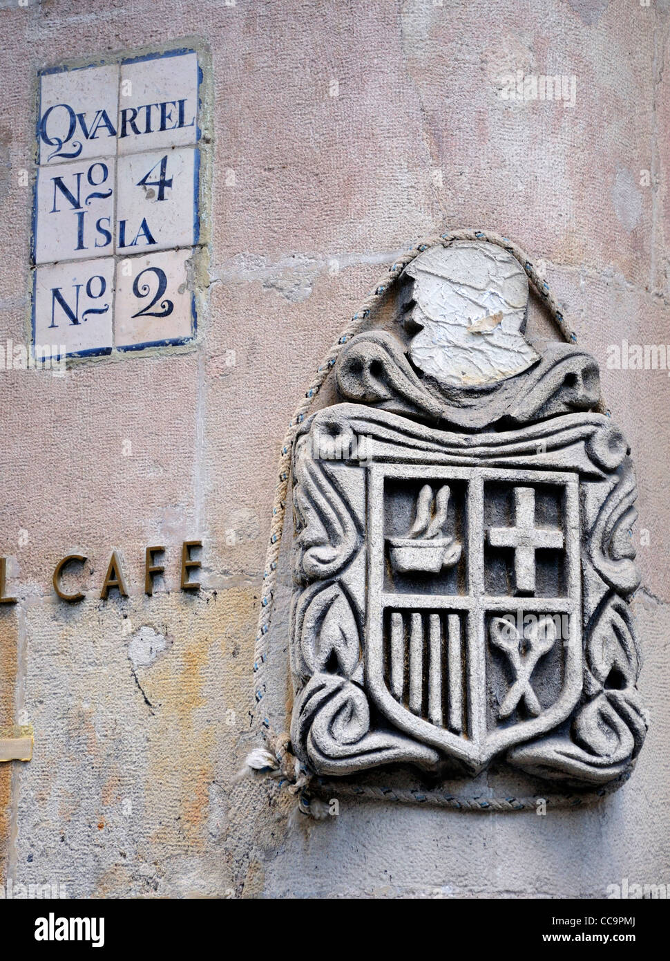 Barcelona, Spain. Wall detail in Carrer del Call. Carved stone, house number and cafe sign Stock Photo