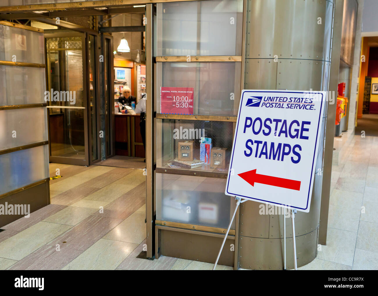 Postage stamps sign in front of post office - Stock Image