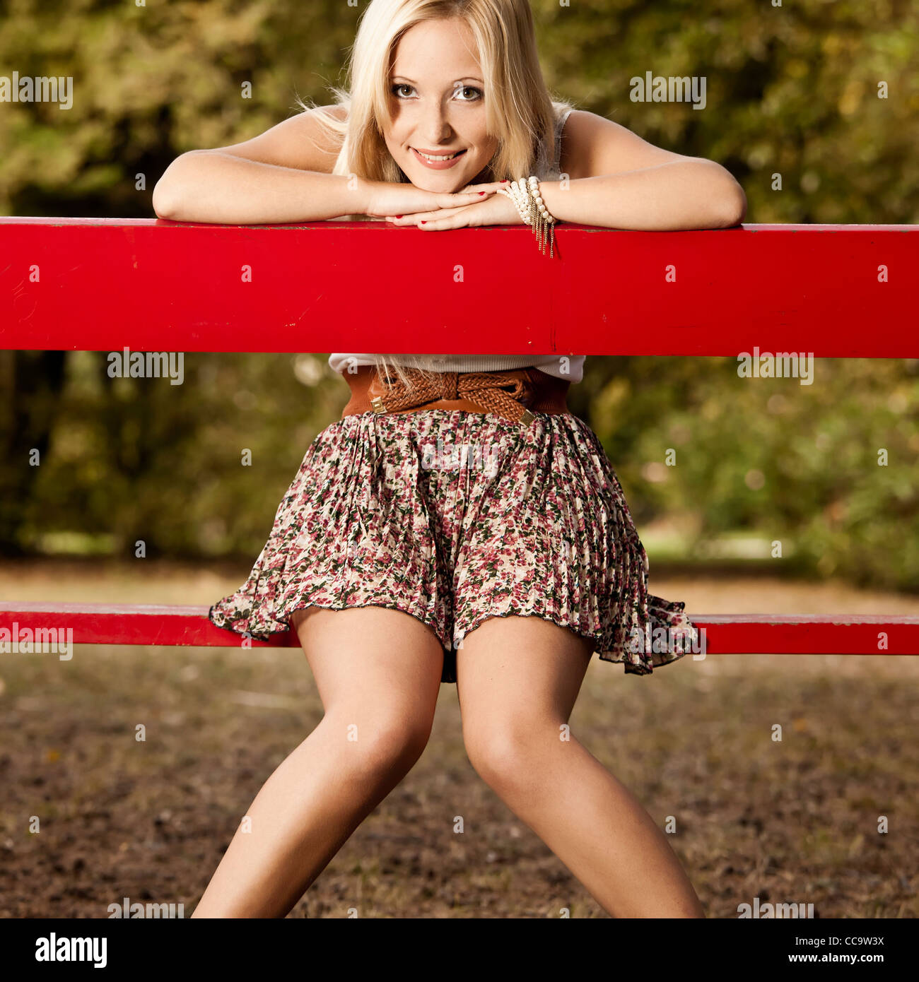 Happy Beautiful Woman Enjoying At Beach Stock Photo: Portrait Of A Beautiful And Happy Young Woman Sitting On A