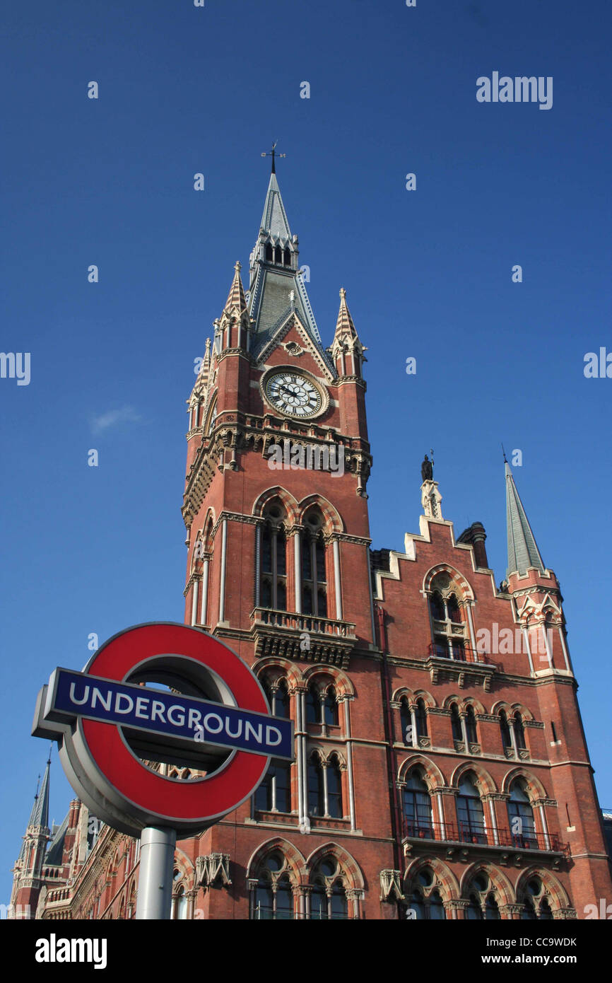 St Pancras Hotel/Chambers, Euston Rd, London N1 blue sky sunny with underground sign in foreground. - Stock Image