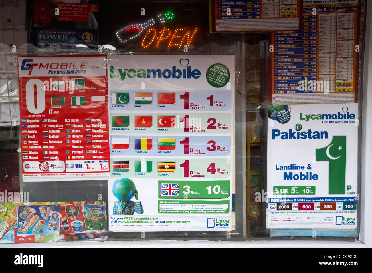cheap international phone cards calling cards advertised in a mobile phone shop window cricklewood north london - International Calling Cards