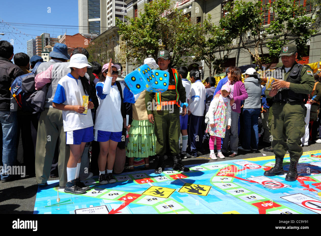 Transport police organise a giant street board game to teach children what road signs mean for Pedestrian Day, La - Stock Image