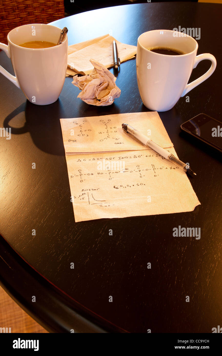 Molecular calculations on paper napkin on coffee shop table - Stock Image