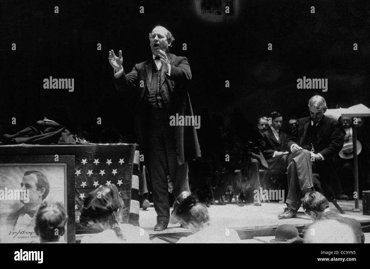William Jennings Bryan standing next to flag draped table on stage during 1908 Democratic National Convention - Stock Image