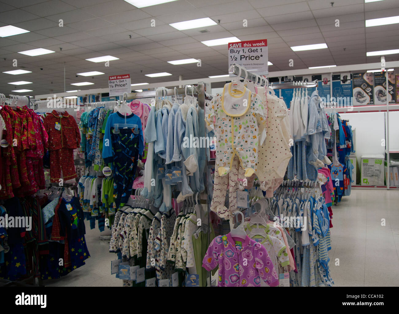 ef38efcd6dc Sale price on baby clothes shown on racks inside a department store - Stock  Image