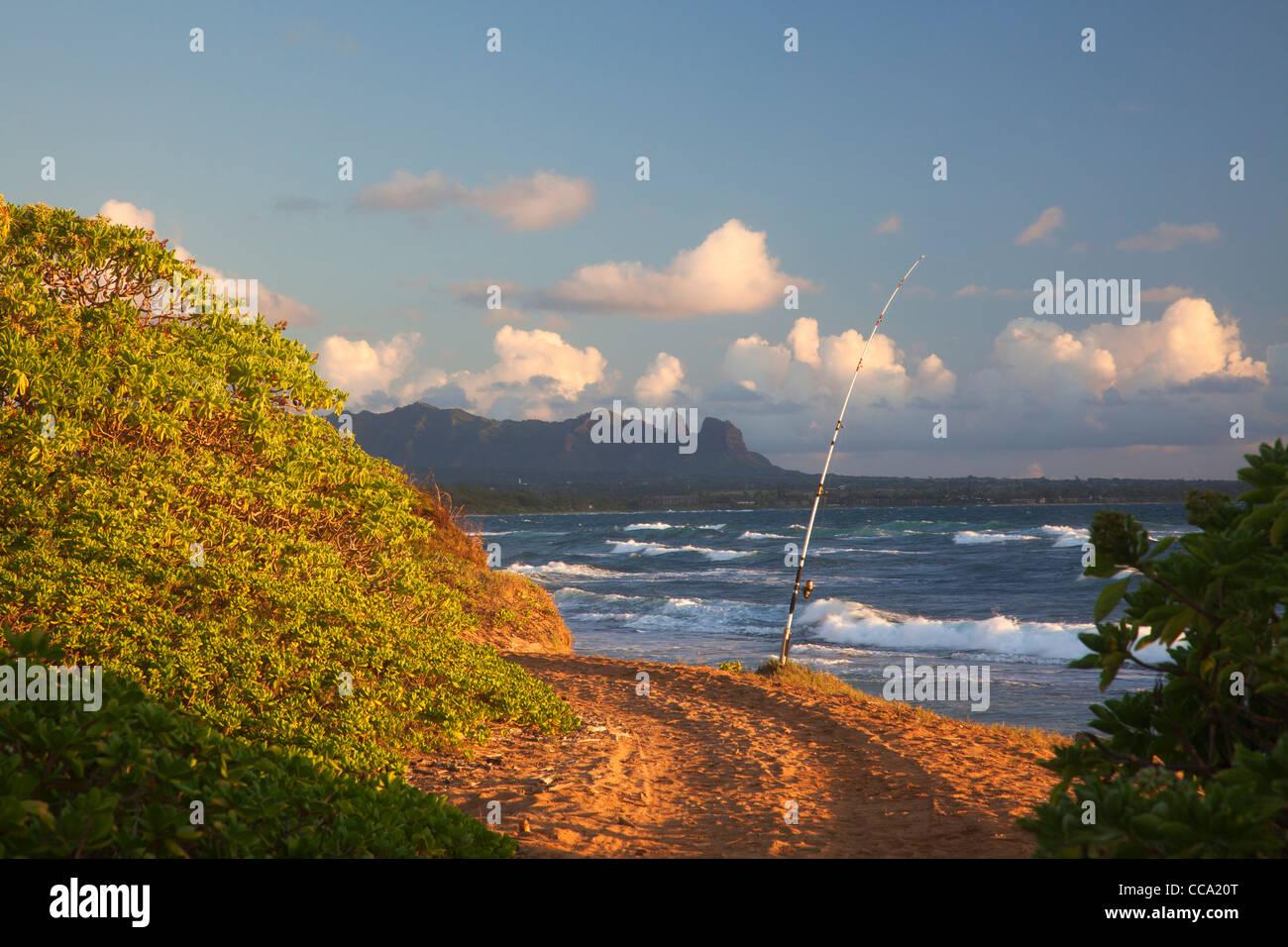 Fishing at Nukoli'i Beach, also known as Kitchens Beach, Kauai, Hawaii. - Stock Image