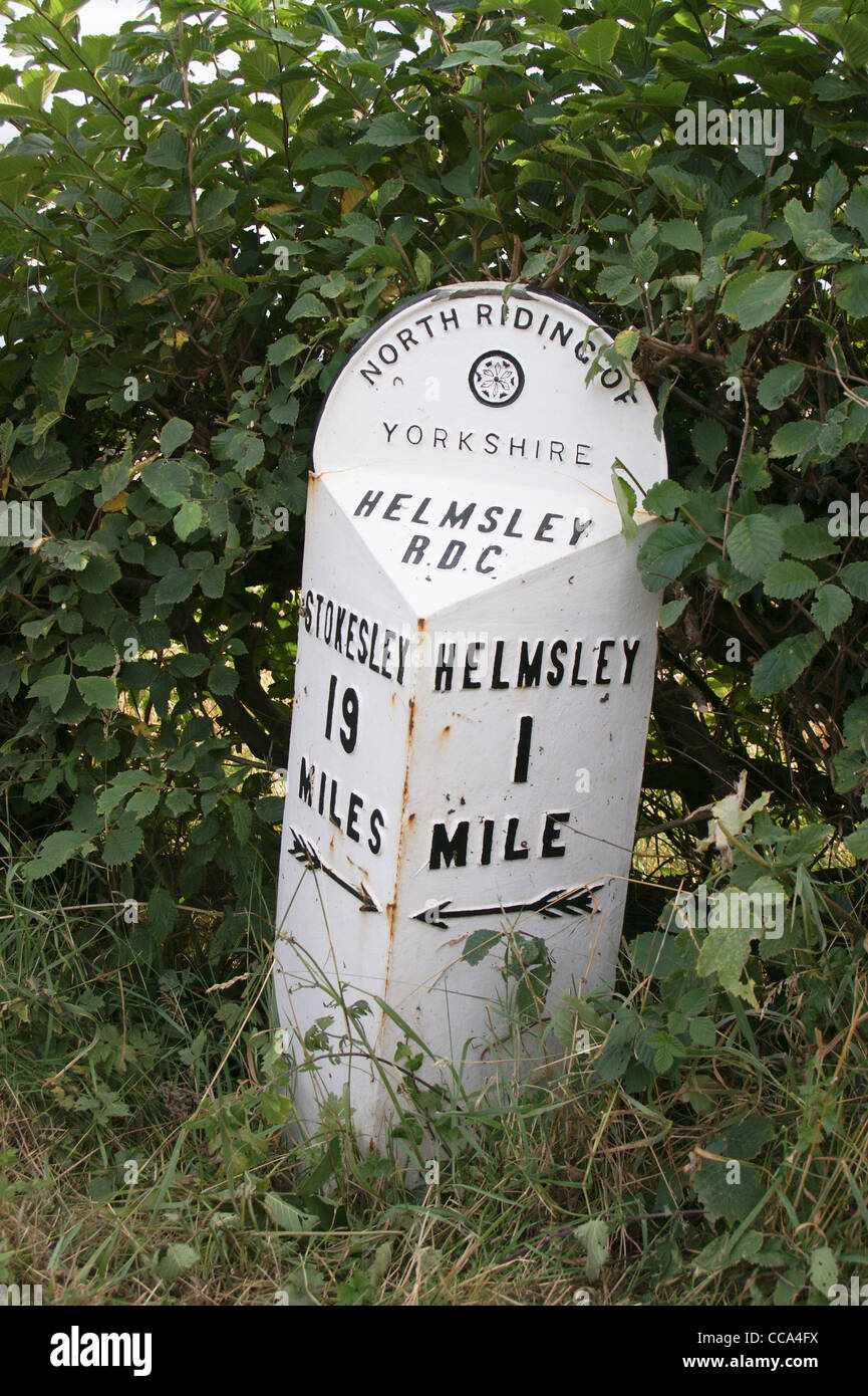 Former Rural District Council iron milepost showing 1 mile to Helmsley, 19 miles to Stokesley,  North Riding, Yorkshire, Stock Photo
