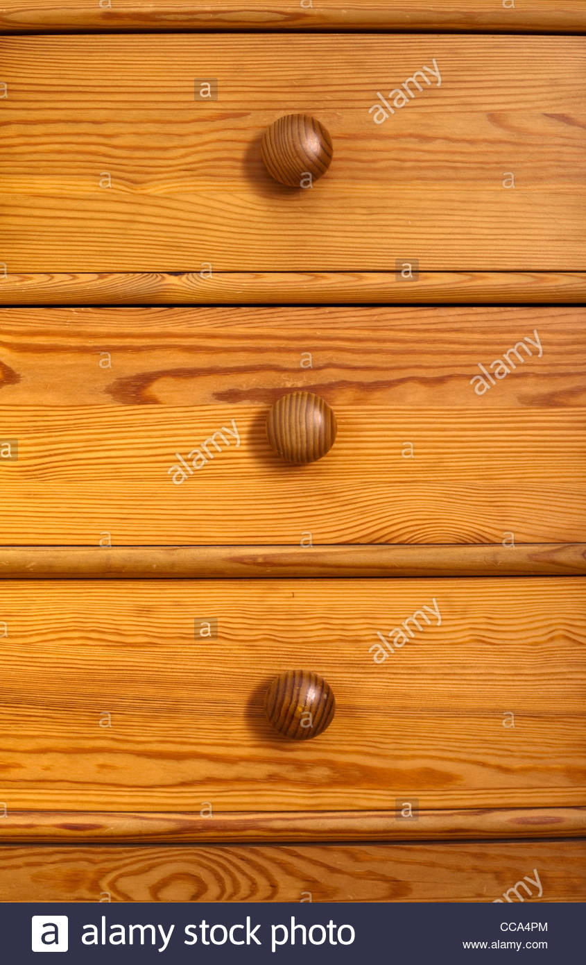 Close up of pine chest of drawers - Stock Image