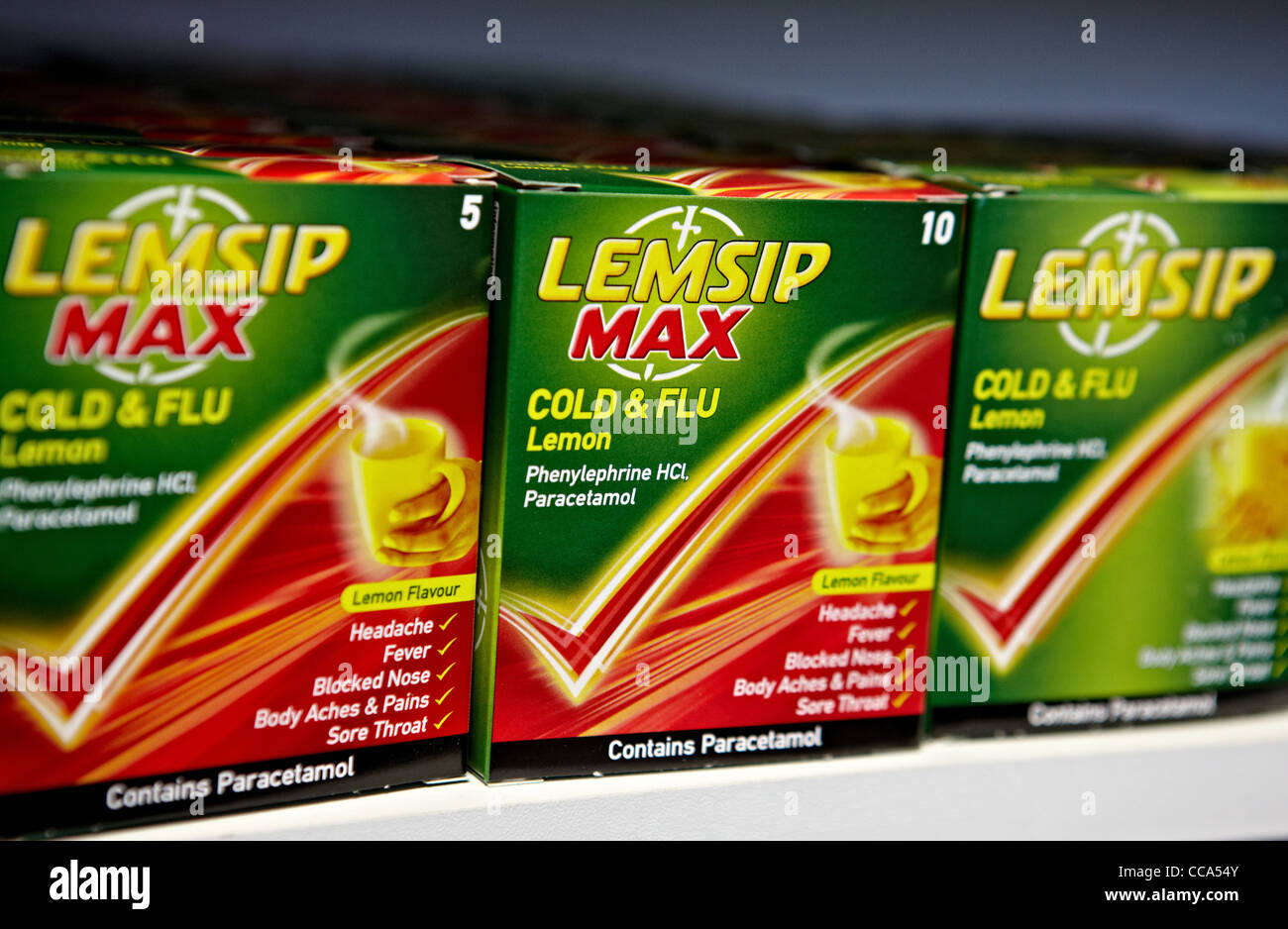 Lemsip packets on a supermarket shelf. Lemsip provides cold and flu relief. - Stock Image