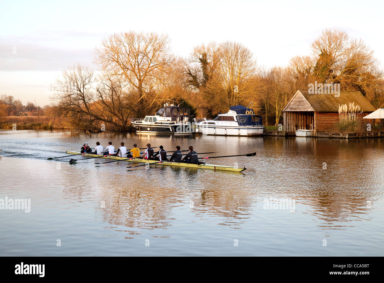 An eight boat rowing on the River Thames at Moulsford, Oxfordshire, UK - Stock Image