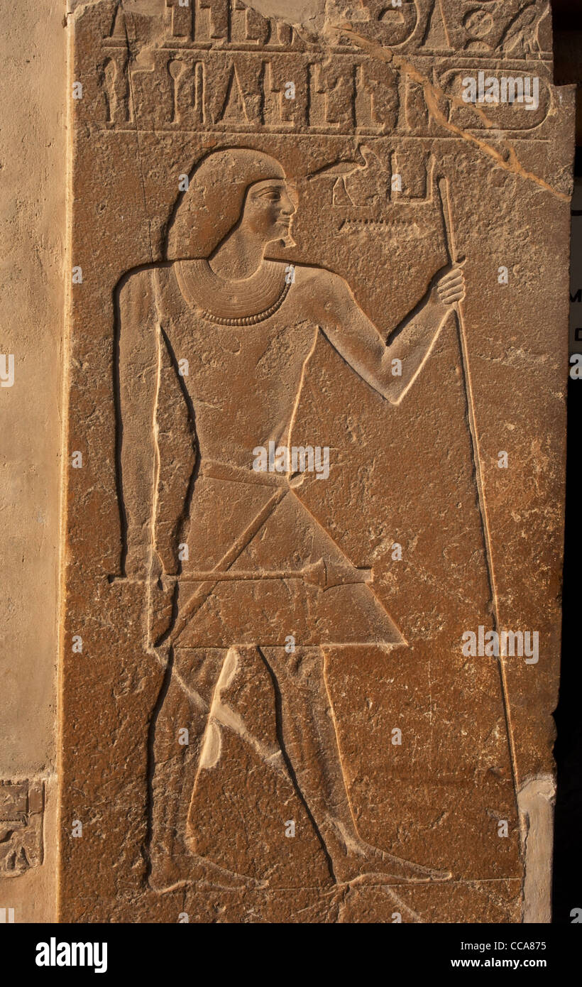 Mastaba of Kagemni (2350 BC). Reliefs on both sides of the door depicting Kagemni with the baton and scepter. Saqqara. - Stock Image