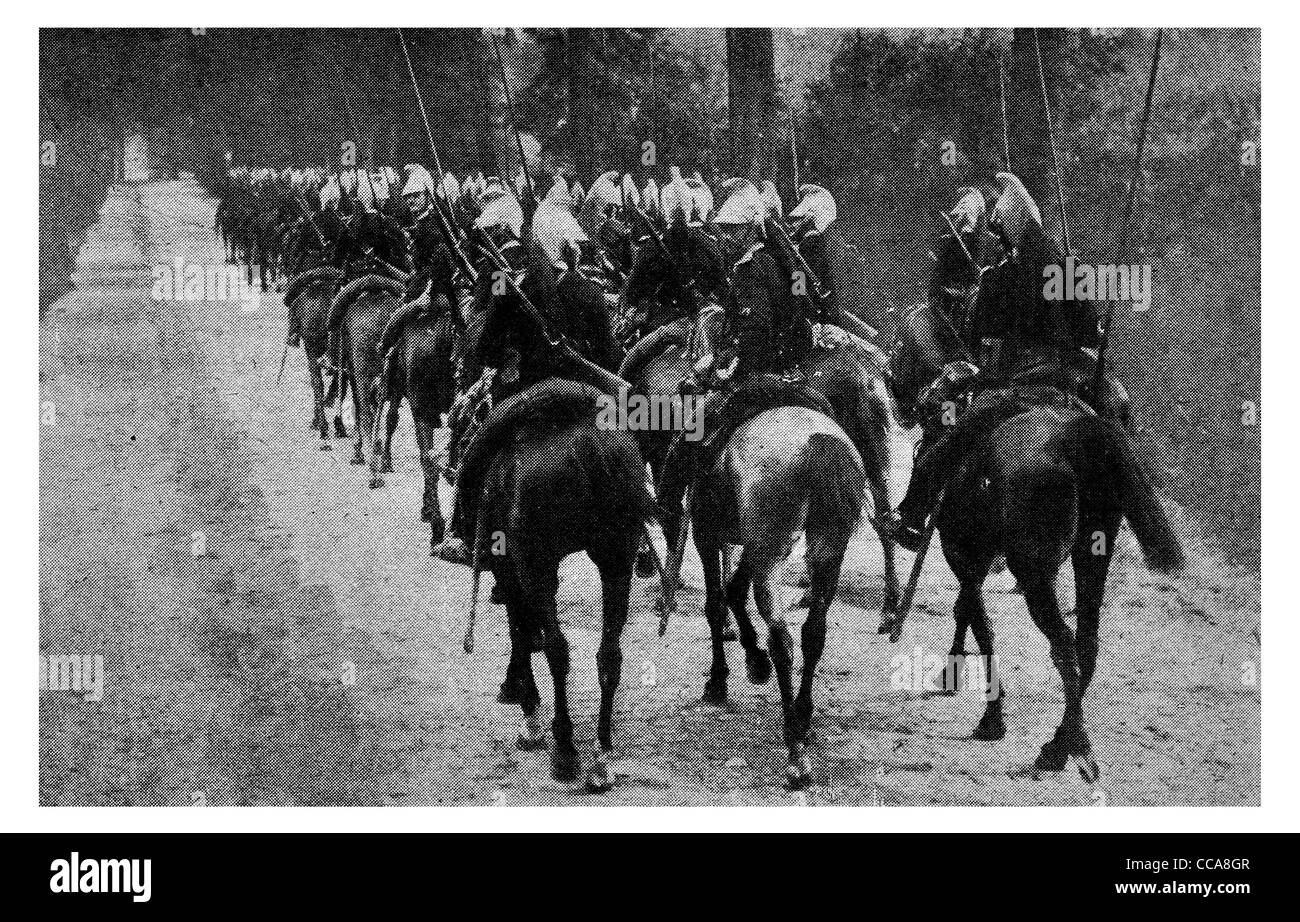 1914 French Cavalry mounted horse uniform lance saber rifle winter snow road marching march column - Stock Image