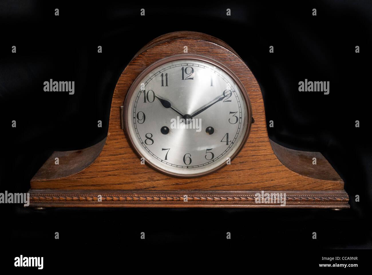 An antique clock mantelpiece. - Stock Image