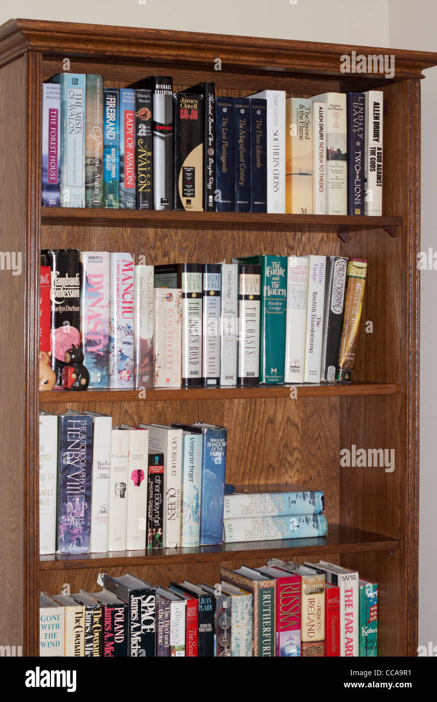 A bookshelf with books. Hardcover historical fiction. - Stock Image