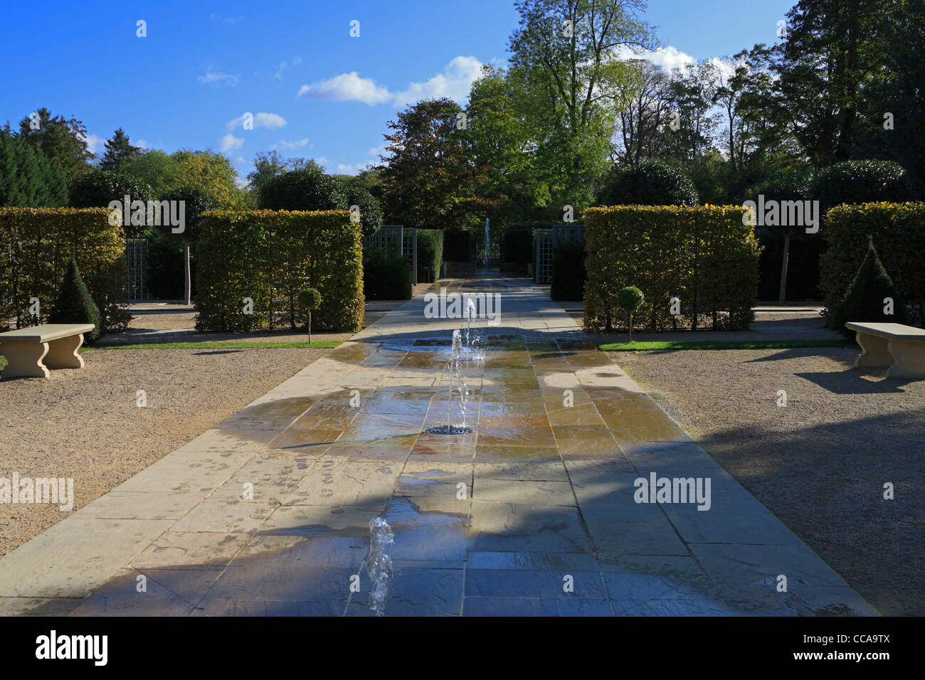 Burghley House Garden of Surprises. Fountains play randomly in the modern formal garden, possibly catching the unwary - Stock Image