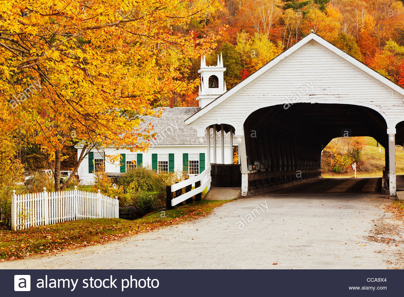 Stark New Hampshire, old Church and Covered Bridge in autumn - Stock Image