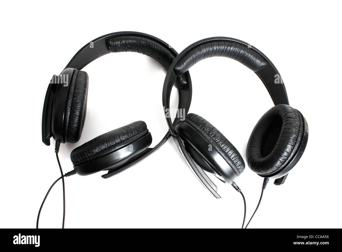 Two headphones isolated on a white background - Stock Image