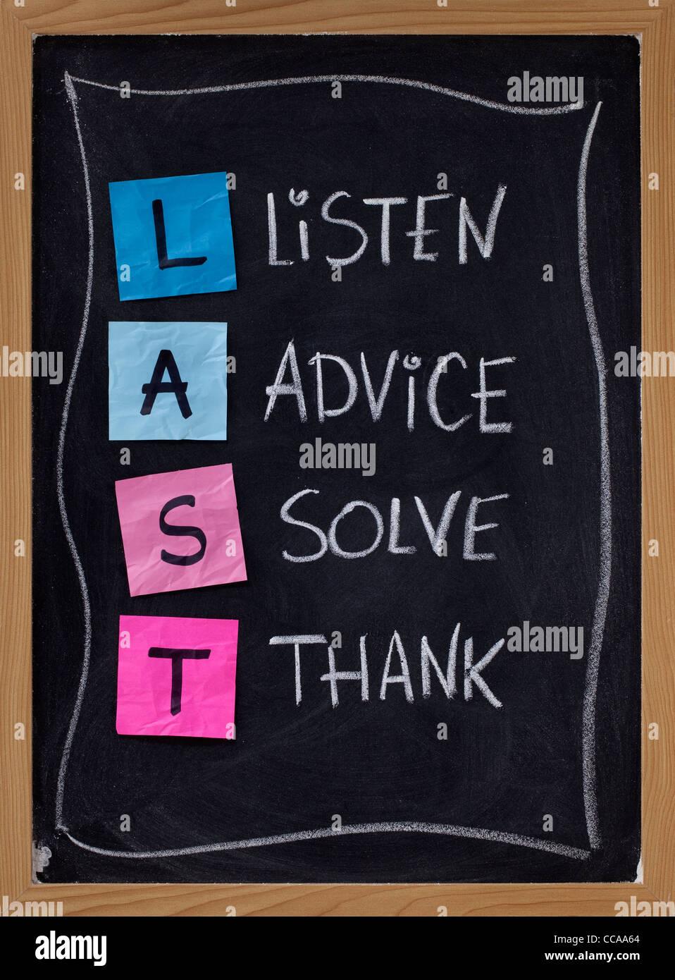 LAST (listen, advice, solve, thank) - acronym for training customer service and complaints handling. blackboard - Stock Image