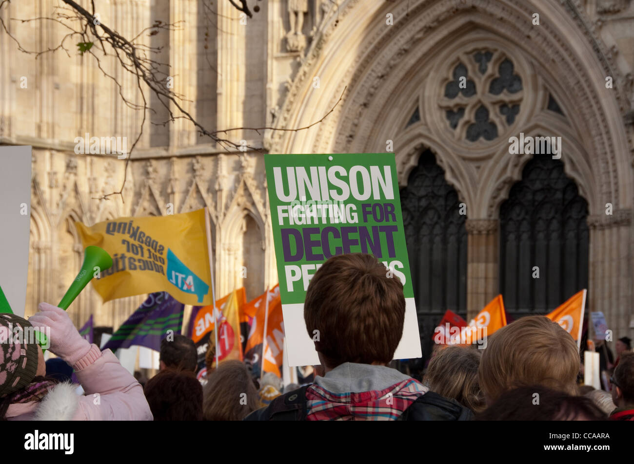 Demonstrators from Unison trade union protest for better pensions outside York Minster North Yorkshire England UK - Stock Image
