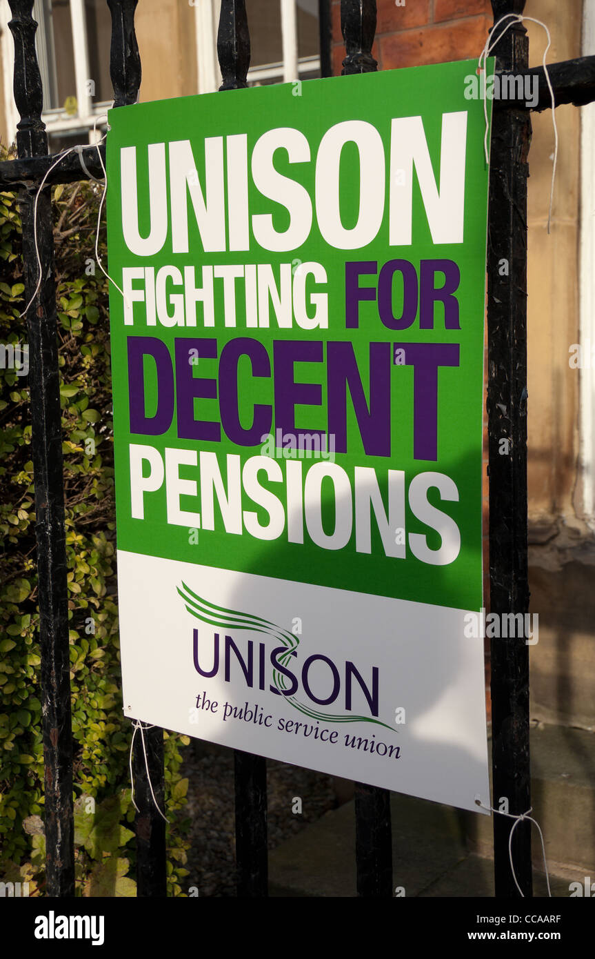 Unison trade union banner tied to railings York North Yorkshire England UK United Kingdom GB Great Britain - Stock Image