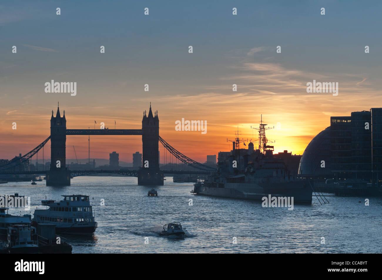 Tower bridge and HMS Belfast at dawn. London UK - Stock Image