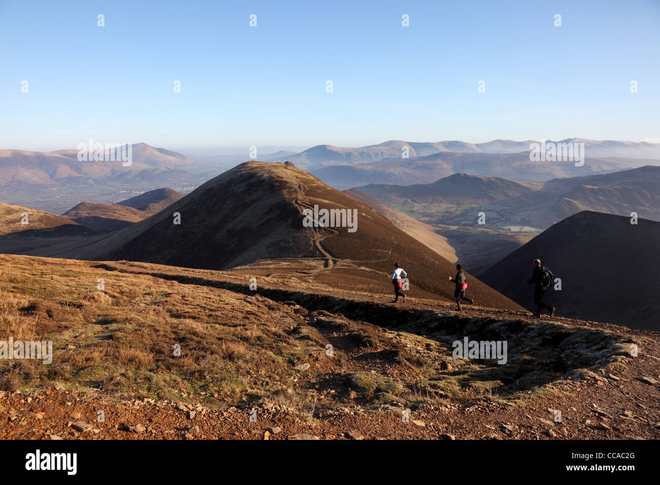 Runners and the View NE from Sail Towards the Summit of Causey Pike Blencathra and the Helvellyn Range Lake District - Stock Image