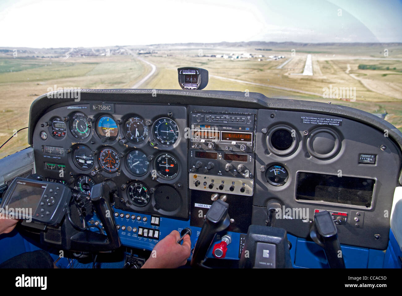 Airstrip landing view from the cockpit of a cessna 172. - Stock Image