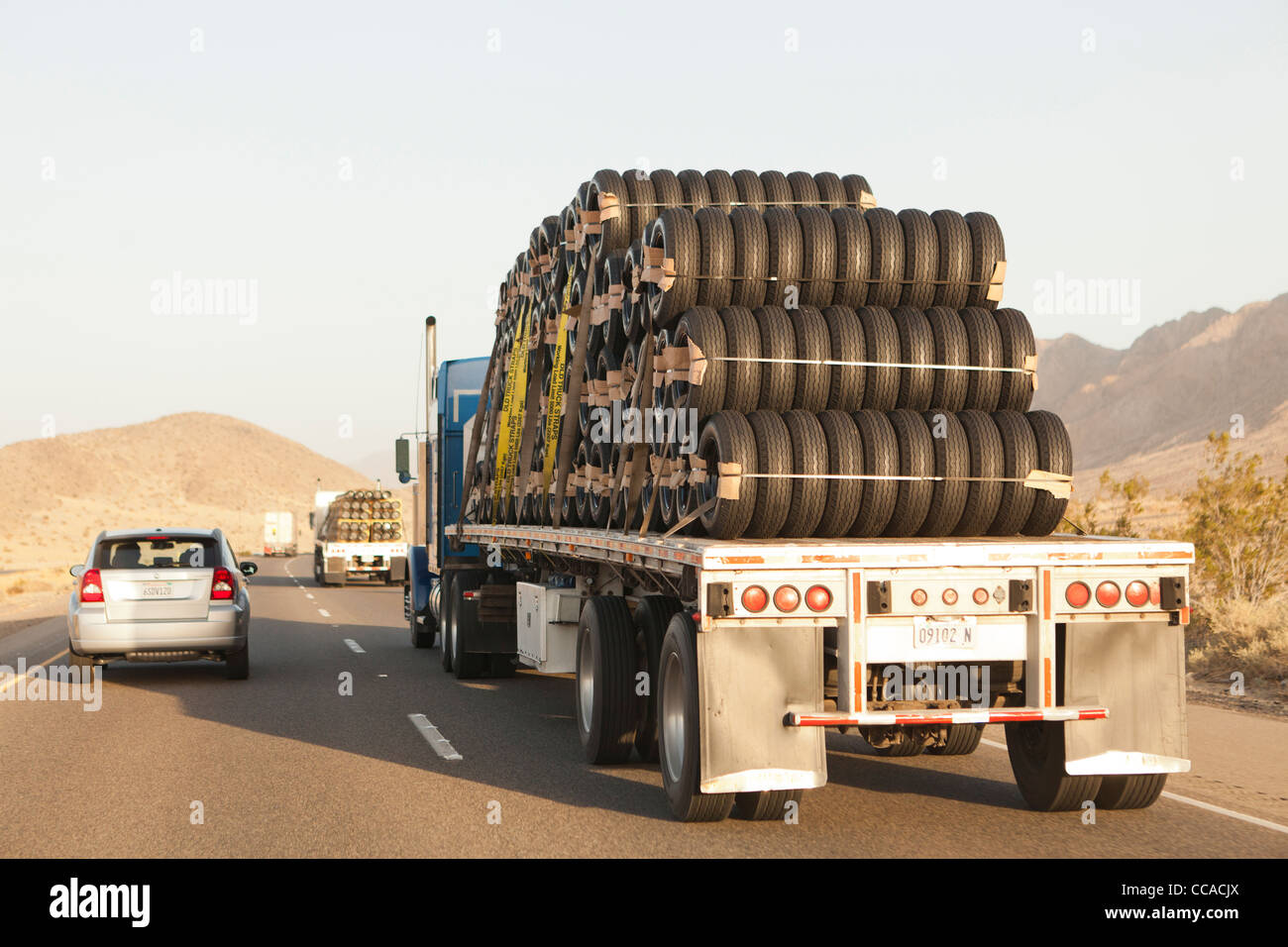 Tractor trailer carrying new tires - Stock Image