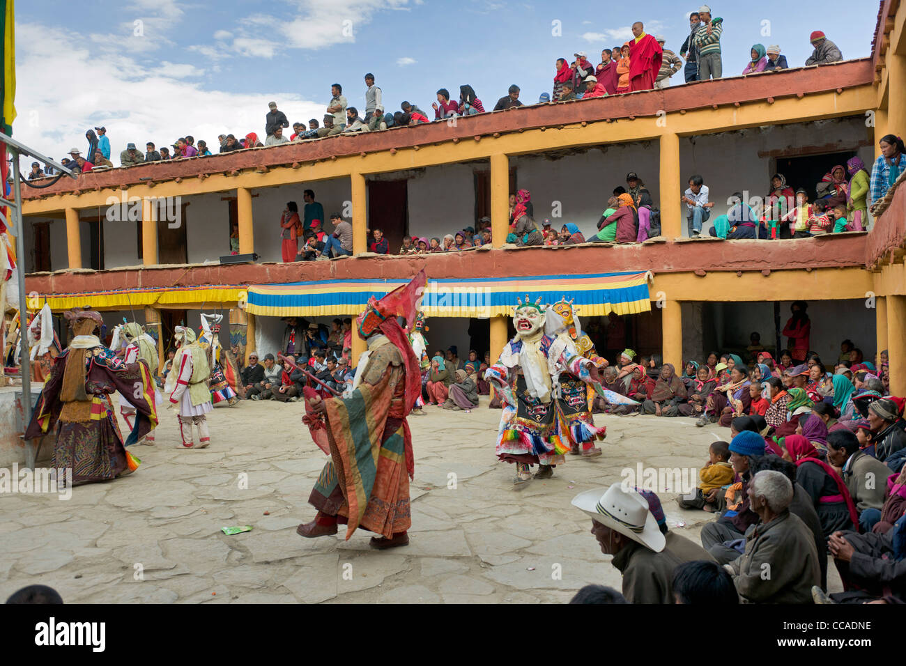 Masked Cham Dancers in the courtyard of Korzok Gompa during the Korzok Gustor, Lake Tsomoriri, (Ladakh) Jammu & - Stock Image