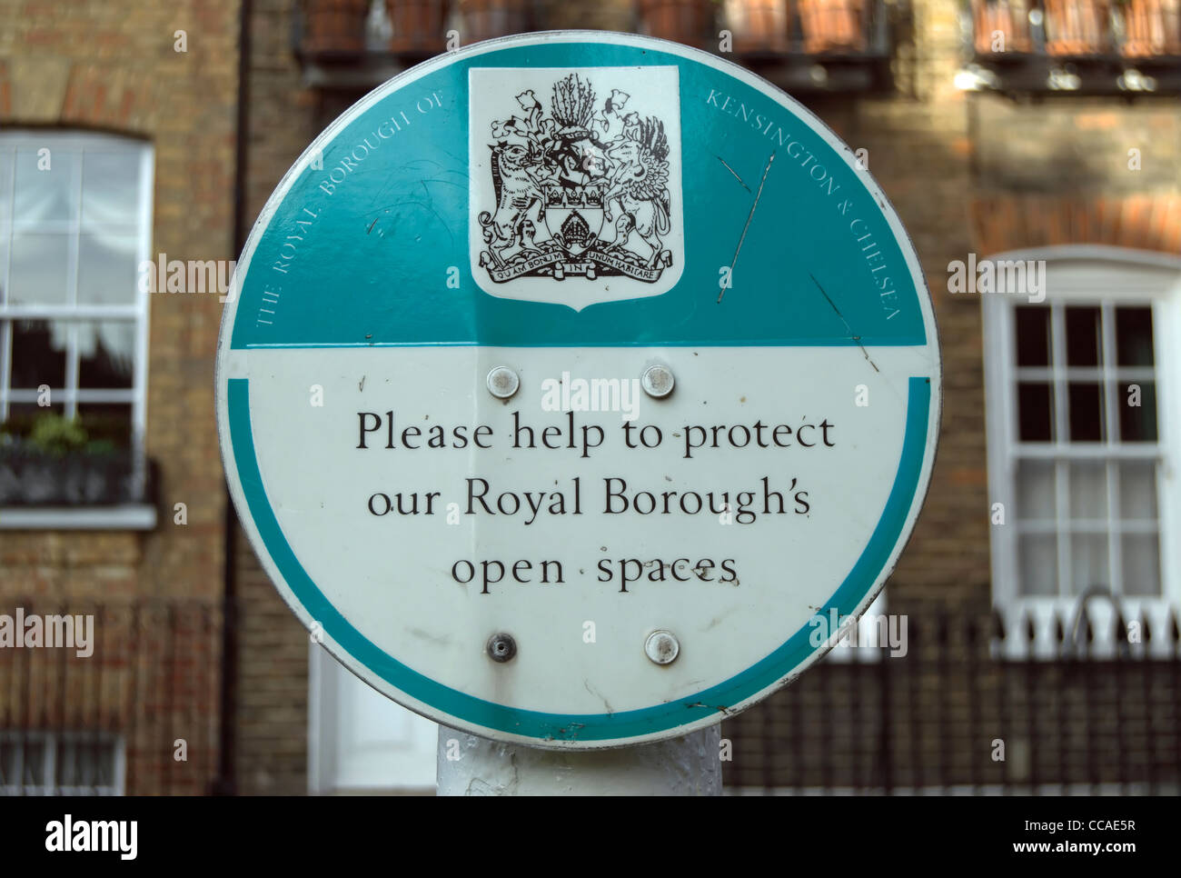 please help protect our royal boroughs open spaces signpost in chelsea, london, england - Stock Image